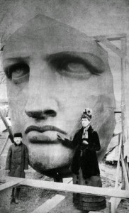 People posing next to the Statue of Liberty as it's unpacked, 1886